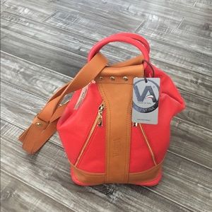 NWT Valentina convertible sling backpack. Red